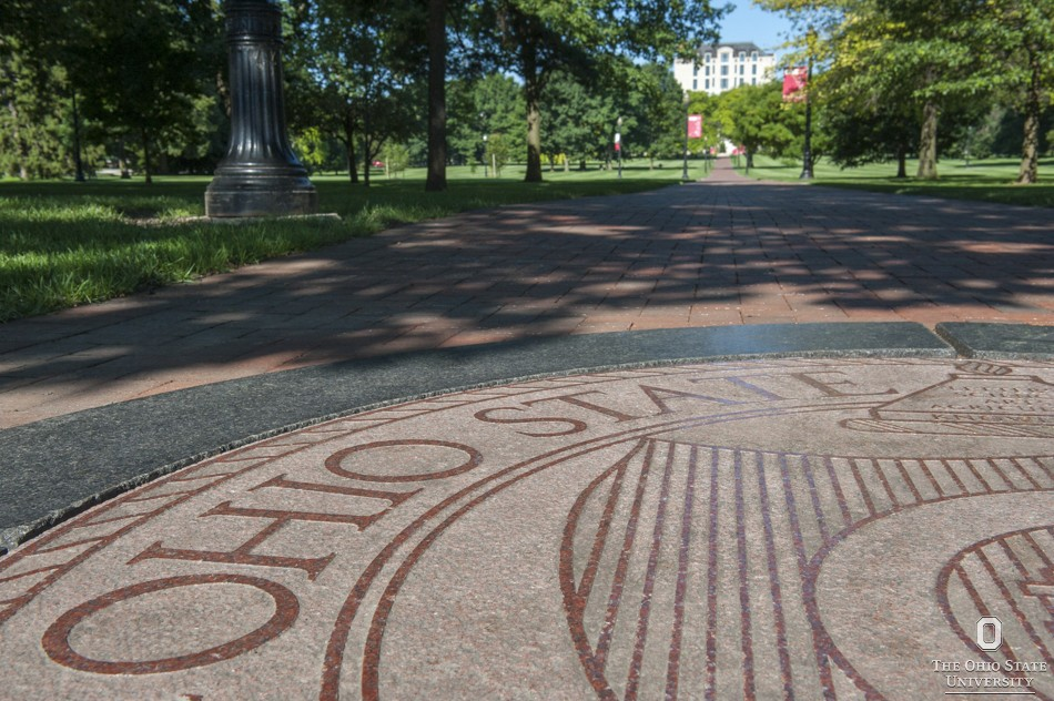 Picture of OSU emblem on a sidewalk on the Oval