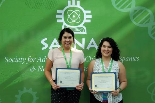Picture of Ally Langley (left) after receiving her SACNAS Conference presentation award. Ally is pictured with fellow presentation award winner Regina Trevino (right), a Chemistry PhD student in the lab of MBTP Trainer, Dr. Hannah Shafaat.